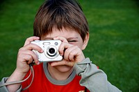 Little boy holding a camera (thumbnail)