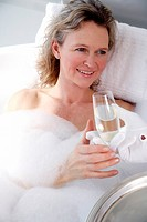 Mature woman enjoying bubble bath