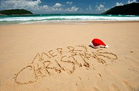 Santa´s hat on a tropical beach