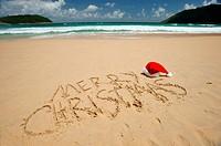 Santa´s hat on a tropical beach