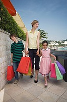 Mother and two children with shopping bags