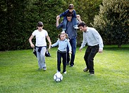 Man and children playing soccer (thumbnail)