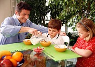 Father and children eating breakfast (thumbnail)
