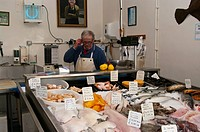 Fishmonger at His Counter in A Fishmongers hastings