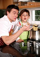 Father and son cooking spaghetti (thumbnail)
