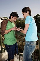 Man reading woman's palm at archaeological site