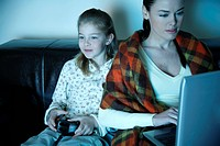 Mother and daughter watching television (thumbnail)