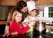 Mother and children cooking (thumbnail)
