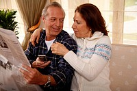 Mature couple relaxing at home
