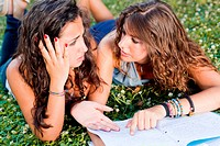 Two Young Woman Study Togheter at Park