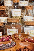 Herbs, flowers and seeds used for natural healing in an apothecary shop. Jars with dried aromatic plant materials and seeds, and medicinal remedies. H...
