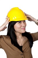 Female Engineer wearing yellow helmet isolated over white background