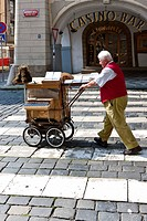Town musician with an old barrel organ, Prague, Czech Republic, Europe
