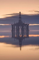 Oil rig anchored in the Cromarty Firth at sunset, Cromarty Firth, Ross_shire, Scotland, UK