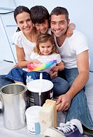 Happy family chosing colours to paint new house