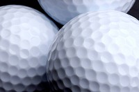 Macro shot of 3 golf balls with space for copy
