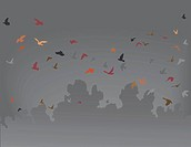 Vector illustration of a flock of flying birds against a gray sky