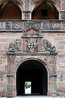 Plassenburg Castle, exit gate from Schoener Hof, beautiful courtyard, with the coat of arms of the Margrave of Brandenburg-Kulmbach above the gate, bu...