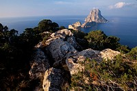 View on Es Vedra island, watchtower Torre del Pirata, Torre de Savinar on Cap del Jueu, Ibiza, Balearic Islands, Spain, Europe