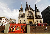 Colombia, Manizales. Low angle view of people on stairs and by bus, church in the background