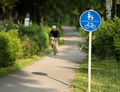Man cycling on a pedestrian and bicycle path