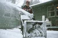 New York, Rochester. Man Using Snowblower