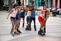 Schoolchildren rollerblading on the Paseo del Prado, Havana,