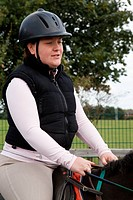 Woman with visual impairment having riding lesson