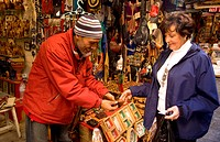 Man Selling Leather To Tourist In Narrow Streets Of The Medina Area Of Tunis, Tunisia
