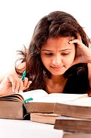 Young Indian serious girl reading old book