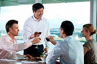 Multi racial businesspeople toasting wine