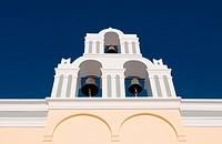 Greek christian church belfry tower with three bells