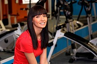 A young smiling woman in a gym