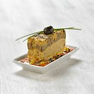 Eggplant caviar with two tapenades and garlic bread terrine
