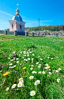small country chapel on spring blossom glade