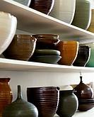 Potteryware on White Shelves