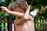 Little boy playing in the garden,