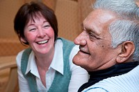 Older man and carer in a care home