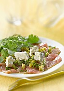 Veal carpaccio with fresh herbs,capers,green olives and Sainte_Maure cheese