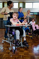 Group of children with physical disabilities exercising