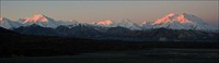 The sun rises along the Alaskan Range.