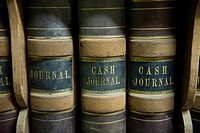 Old journals collect dust on a shelf at a bank in Talmage, NE.