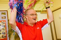 Day Service user with learning disabilities doing cheerleading,
