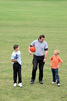 Man and boys with football