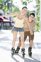 Young Woman Learning to Inline Skate