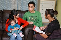 Professional visiting chinese family at home