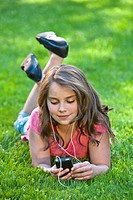 Young girl outdoors listening to music