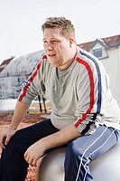 Man sitting on fitness ball