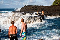 Queens Bath is located in Princeville on Kauai, Hawaii, USA. A trail down the cliff takes you to volcanic rocks and the tumultuous ocean. Locals cliff...