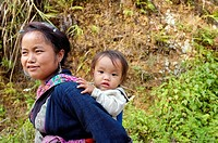 Black Hmong woman carrying baby on her back, Sapa, North Vietnam